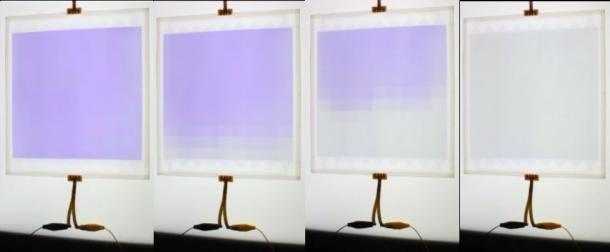 図1 遮光状態(左端)から透明(右端)にグラデーション変化する調光ガラス(サイズ:20  20 cm)