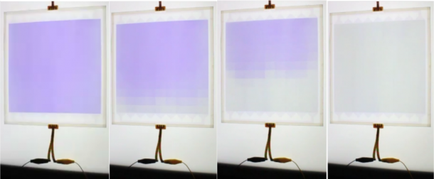 Figure 1. Dimming glass (20 cm  20 cm) whose darkness can be varied from a completely darkened state (left) to a completely clear state (right)